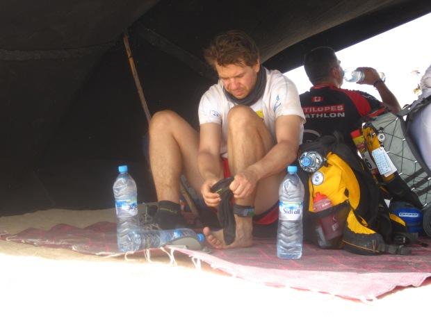 Changing socks at a Saharan checkpoint.