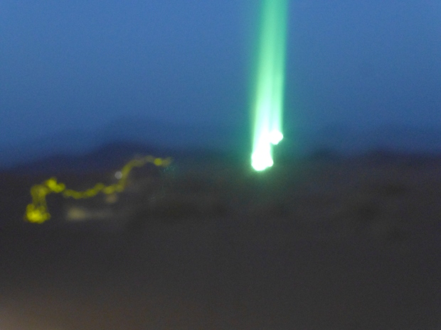 The green laser in the sky.