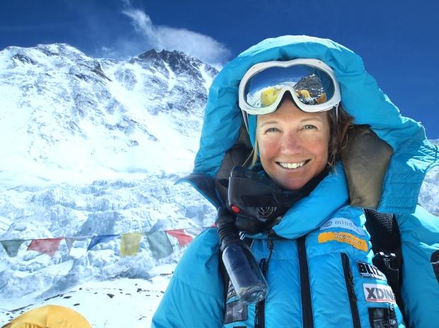 Climbing the highest peak in the world.