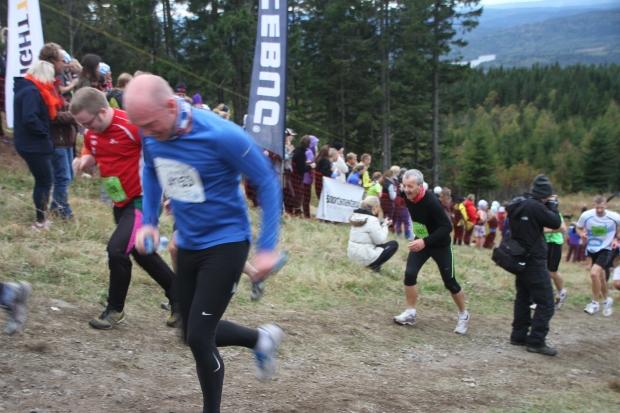 Dad pushing a hard sprint finish.