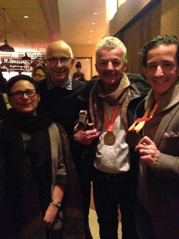 Proud marathoners with our coach (far left) post-race.