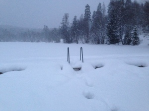 View of a Sognsvann pier standing on the frozen water.