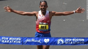 Meb Keflezighi of the US, crosses the finish line to win the Men's Elite division of the 118th Boston Marathon in Boston, Massachusetts April 21, 2014 .  AFP PHOTO / Timothy A. CLARY
