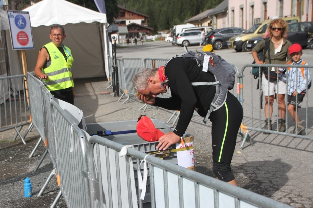 Dad soaking his head at the penultimate checkpoint at Vallorcine.